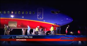 This frame grab provided by KSPR-TV shows a Southwest Airlines flight that was scheduled to arrive Sunday at Branson Airport in southwest Missouri instead landed at an airport 7 miles north — with a runway about half the size of the intended destination.