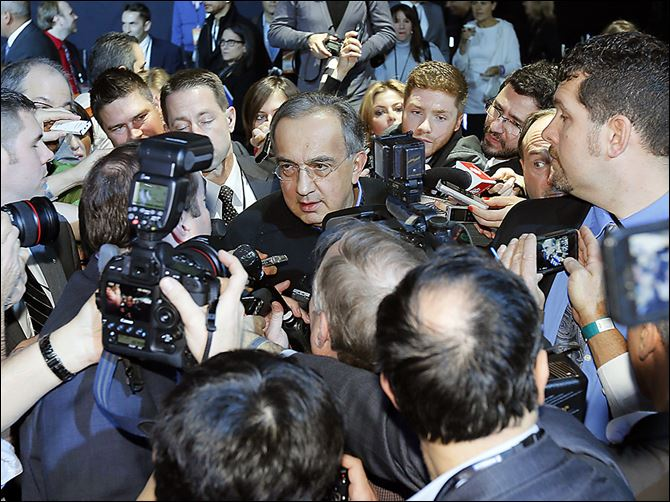 n3auto Chrysler Group CEO Sergio Marchionne fields questions from the international press at the auto show. He said Monday Toledo will continue to build the wildly popular Jeep Wrangler, the next generation of which will appear in about 2 years.