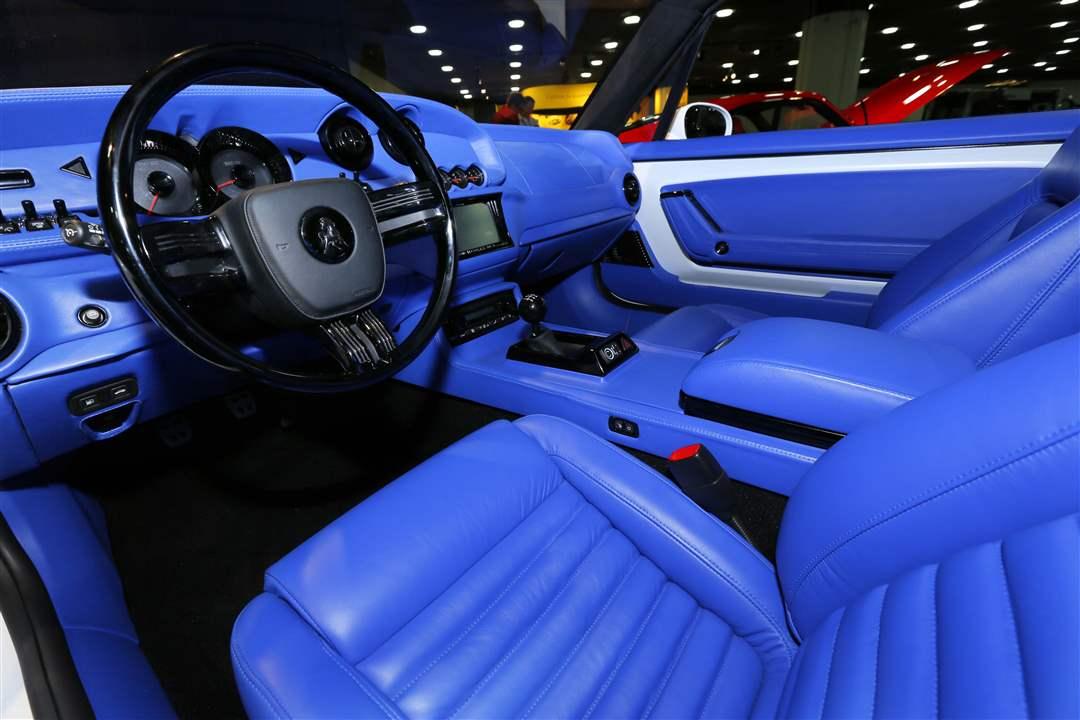 Great BIZ AutoShow15p 12. A White Equus Bass 770 Features An Electric Blue  Interior.
