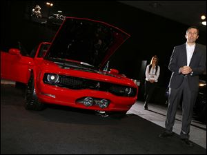 Brand ambassador Ian James speaks about the Equus Bass 770 at the North American International Auto Show in Detroit, Tuesday, Jan. 14, 2014.