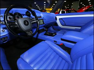 A white Equus Bass 770 features an electric blue interior.