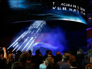 Members of the media wait for the Acura TLX prototype to be unveiled.