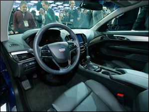 A view of the interior of the 2015 Cadillac ATS Coupe.