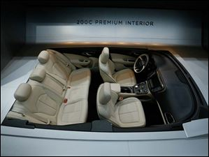 A display shows the interior of the Chrysler 200C.