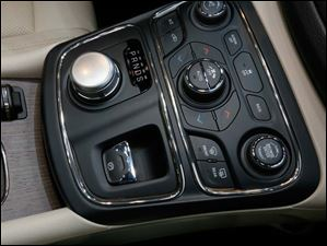 A rotary shifter is one of the new features of the Chrysler 200C on display at the North American International Auto Show.