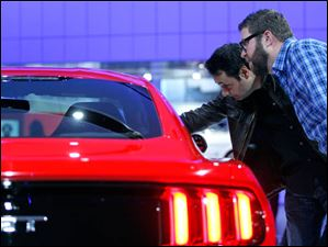 Top Gear television stars Adam Ferrara, left, and Rutledge Wood, right, check out the 2015 Mustang GT.