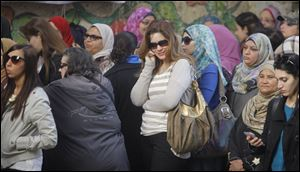Egyptian voters line up outside a polling station in Cairo today.