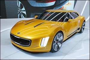 Analysts say Kia is working hard to get away from its image as an economy brand with its GT4 Stinger concept car.