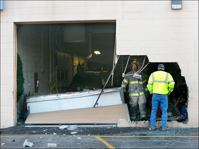 CTY accident vehicle into building Authorities look at the hole left by a vehicle that drove into a building at 3622 W. Sylvania Ave, near Christ the King Church early today.