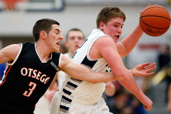Lake-s-Jacob-Rettig-22-steals-from-Otsego-s-Jalen-Myers-3