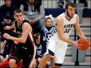 Lake's Todd Walters (10) steals the ball from Otsego's Schyler Scherff (20).