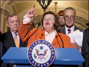 Senate Appropriations Committee Chair  Sen. Barbara Mikulski, D-Md., flanked by Senate Majority Whip Richard Durbin of Ill., left, and Sen. Charles Schumer, D-N.Y., speaking on Capitol Hill in Washington.