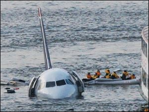 Jan. 15, 2009, passengers in an inflatable raft move away from US Airways Flight 1549 that went down in the Hudson River in New York. Capt.