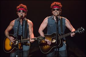 Bruce Springsteen, left, and Jimmy Fallon perform during