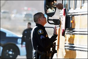 Law enforcement personnel set up a perimeter following the shooting Tuesday.
