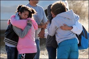 Students are reunited with family following a shooting at Berrendo Middle School, Tuesday in Roswell, N.M.
