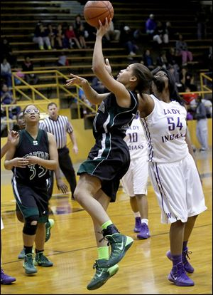Mariah White shoots in front of Waite's Latesha Craig. White had 16 points while Craig had 15.