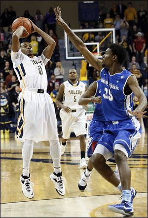 University of Toledo guard Julius Brown (20) hits the game winning shot against Buffalo forward Xavier Ford (35) today.