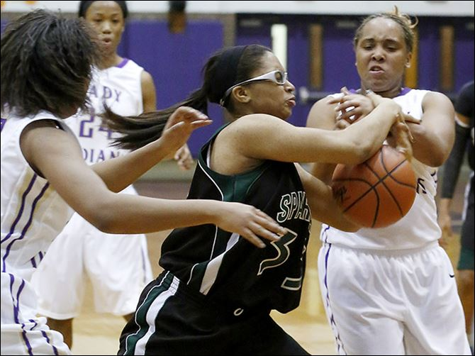 s5turner Start's Akyshia Turner and Waite's Sharena Gary battle for possession.