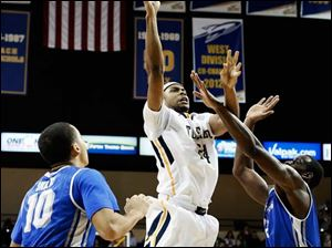Toledo forward J.D. Weatherspoon (24) shoots against Buffalo forward Javon McCrea (12).