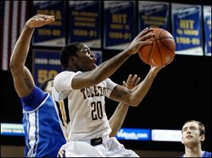 Toledo guard Julius Brown (20) goes to the basket against Buffalo.