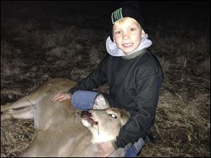 Owen Timbrook, 7, shot a white-tailed doe with a crossbow in Williams County.