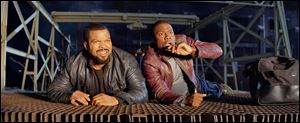 "Ice Cube, left, and Kevin Hart in a scene from ""Ride Along."""