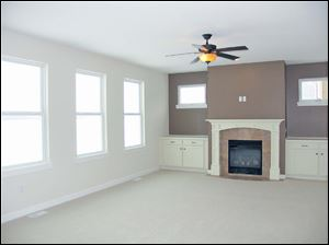 The family room fireplace is ready to serve as your family photo backdrop.