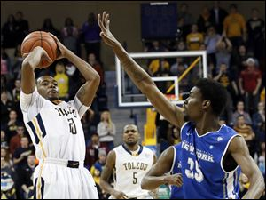 University of Toledo guard Julius Brown (20) hits the game winning shot against Buffalo forward Xavier Ford (35) during a basketball game Wednesday, Jan. 15, 2014, at Savage Arena in Toledo. UT defeated Buffalo 67-65.