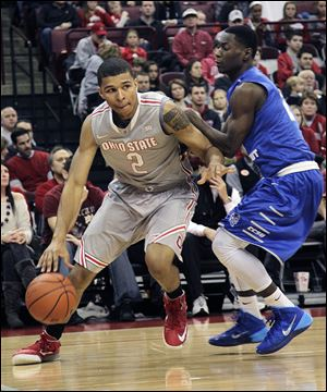 Ohio State's Marc Loving dribbles against Central Connecticut's Matt Mobley. The freshman is averaging 6.6 points and is the latest in a long line of Toledo talent to play for the Buckeyes.