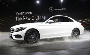 Mercedes Benz unveils the new C-Class car at the North American International Auto Show in Detroit. Mercedes was the top-selling luxury brand once again last year, outselling second-place BMW by more than 25,000 vehicles.