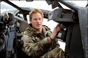Britain's Prince Harry makes his early morning pre-flight checks on the flight-line, from Camp Bastion southern Afghanistan in December, 2012.