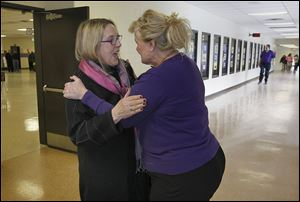 Joan Osborn-Van Guten, left, retired Waite High business education chairman, greets Hazel Munding, administrative assistant to the principal, during the school's centennial celebration.