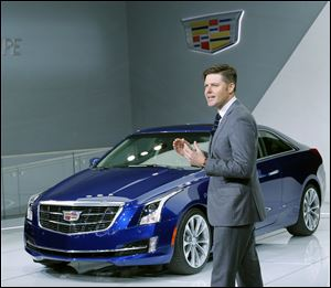 Andrew Smith, executive director of Global Cadillac design, speaks about the 2015 ATS Coupe, its concept car at the auto show.