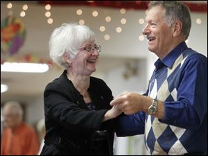 Judy Diener and her husband Ron Diener from Temperance, MI, dance together.