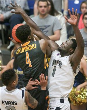 Toledo's Justin Drummond drives against Akron's Demetrius Treadwell. Drummond was limited to four points for the Rockets.