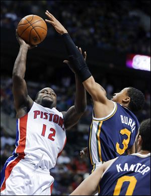 Detroit Pistons guard Will Bynum (12) takes a shot against Utah Jazz guard Trey Burke (3) Friday in Auburn Hills, Mich.