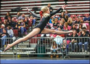 Toledo Turner gymnast Kylie Morgan performs. Kevin McKee, Ottawa Hills physical education teacher and local gymnastics coach, says the girls, who range in age from 5 to 18, get a taste for competition during events such as the Battle of Champions.