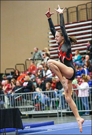 Toledo Turner's Kate Ellis, 11, performs in the floor exercise at the Battle of Champions.