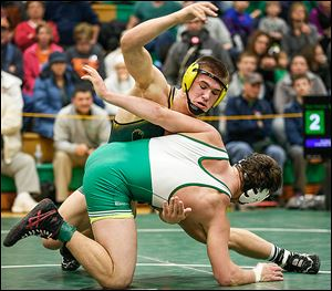 Clay's Matt Stencel, top, defeats Delta's Ryan Patchin 5-2 in the 182 pound championship match of the Maumee Bay Classic on Saturday in Oregon.