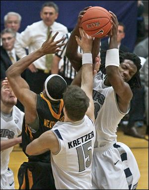 J.D. Weatherspoon battles Jake Kretzer (15) of Akron and Quincy Diggs. Weatherspoon had a career-high 20 points and 14 rebounds.