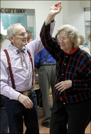 Fred Miller and his wife Remona Miller, from Sylvania, take a spin on the dance floor during a Happy Feet Dancers event, which is open to the public.