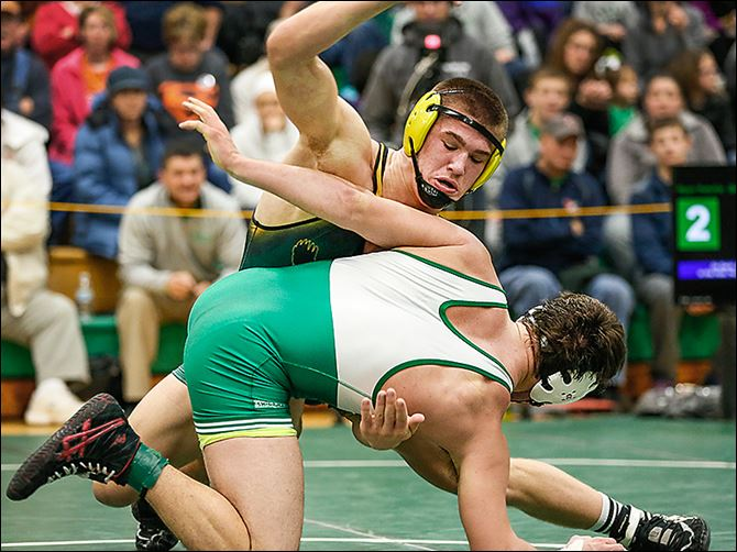19s1stencel-3 Clay's Matt Stencel, top, defeats Delta's Ryan Patchin 5-2 in the 182 pound championship match of the Maumee Bay Classic on Saturday in Oregon.