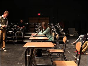 Connor Treece, left, and Sara Miller rehearse 'Thistle Blossoms.'