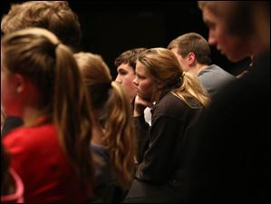 Emma Hayward, 15, center, and her fellow theater students watch their fellow actors during practice.