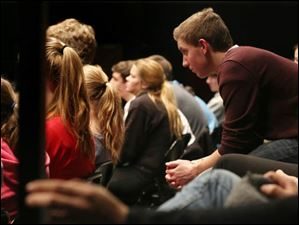 Jacob Saunders, 16, right, leans forward to watch his fellow theater students during practice.