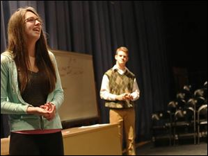 Sara Miller, left, and Connor Treece, center, rehearse 'Thistle Blossoms.'