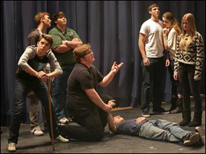 Senior Connor Leupp, center, and his fellow cast members practice for the Winter One Acts.