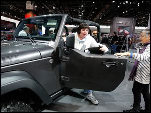 Gloria Wise, of Troy, Mich, steps out of a 2014 Wrangler Willys Wheeler at the show. With her is her mom, Jo Dunphy, of Yellow Springs, Ohio.