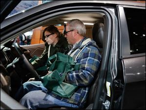 Andrew Gierak, behind the wheel, and his daughter Anna Gierak, in a 2014 Jeep Cherokee.